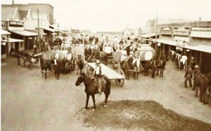 Cotton growers on their way to the cotton gin. Main street, looking North. photo circa 1914
